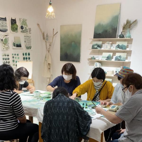 Workshop participants are painting