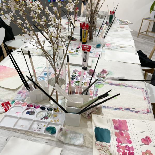 Art supplies and Sakura during the workshop